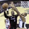 Miami Heat\'s LeBron James (6) shoots as San Antonio Spurs\' Tim Duncan (21) defends during the first half at Game 4 of the NBA Finals basketball series, Thursday, June 13, 2013, in San Antonio. (AP Photo/Lucy Nicholson)