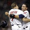 Photo - Cleveland Indians' Mike Aviles, right, hugs Matt Carson (7) after Carson's bases-loaded single in the 11th inning gave the Indians a 2-1 win over the Houston Astros in a baseball game Thursday, Sept. 19, 2013, in Cleveland. (AP Photo/Mark Duncan)
