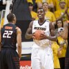 Missouri\'s Ricardo Ratliffe, right, holds the ball after being fouled while shooting as Oklahoma State\'s Markel Brown, left, walks away during the first half of an NCAA college basketball game Wednesday, Feb. 15, 2012, in Columbia, Mo. Missouri won the game 83-65. (AP Photo/L.G. Patterson) ORG XMIT: MOLG104
