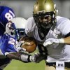 Kingfisher\'s Jeremy Smith (8) gets past Millwood\'s Allen Starks (20) during the Class 2A State semifinal football game between Millwood High School and Kingfisher High School on Saturday, Dec. 5, 2009, in Yukon, Okla. Photo by Chris Landsberger, The Oklahoman