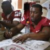 Running back Roy Finch signs autographs during fan appreciation day for the University of Oklahoma Sooner (OU) football team at Gaylord Family-Oklahoma Memorial Stadium in Norman, Okla., on Saturday, Aug. 3, 2013. Photo by Steve Sisney, The Oklahoman