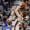 Utah Jazz shooting guard Gordon Hayward, right, shoots as Minnesota Timberwolves point guard Alexey Shved (1) defends and Timberwolves point guard Luke Ridnour (13) looks on in the first quarter during an NBA basketball game on Wednesday, Jan. 2, 2013, in Salt Lake City. (AP Photo/Rick Bowmer)