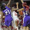 Oklahoma Sooners\' Sharane Campbell (24) shoots between TCU Horned Frogs\' Latricia Lovings (21) and Natalie Ventress (24) in the second half as the University of Oklahoma (OU) Sooners defeated the Texas Christian University (TCU) Horned Frogs 82-54 in women\'s college basketball at the Lloyd Noble Center on Wednesday, Dec. 28, 2011, in Norman, Okla. Photo by Steve Sisney, The Oklahoman