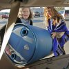 Catherine Webb (left) and Karen Chapman load a rain barrel into a car after a giveaway and workshop on how to use them on Saturday, Jan. 21, 2012, in Norman, Okla. Photo by Steve Sisney, The Oklahoman