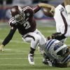Photo - Texas A&M quarterback Johnny Manziel (2) is taken down by Duke linebacker Kelby Brown (59) in the first half of the Chick-fil-A Bowl NCAA college football game Tuesday, Dec. 31, 2013, in Atlanta. (AP Photo/John Bazemore)