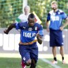 Photo - Italian player Mario Balotelli warms up during a training session in Coverciano training complex, in Florence, Italy, Tuesday, May 20 , 2014. The Azzurri will train for three days this week then resume full-time preparation next Monday. In Brazil, Italy is in Group D with England, Uruguay and Costa Rica. (AP Photo/Fabrizio Giovannozzi)
