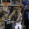 Photo - San Antonio Spurs forward Boris Diaw, left, of France, tries to block the shot of Sacramento Kings guard Isaiah Thomas during the first quarter of an NBA basketball game in Sacramento, Calif., Friday, March 21, 2014.(AP Photo/Rich Pedroncelli)