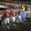 The ou team takes the field before the Fiesta Bowl college football game between the University of Oklahoma Sooners and the University of Connecticut Huskies in Glendale, Ariz., at the University of Phoenix Stadium on Saturday, Jan. 1, 2011. Photo by Bryan Terry, The Oklahoman