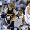 Marquette\'s Cristina Bigicaleft, left, fights for a loose ball with Connecticut\'s Kaleena Mosqueda-Lewis during the first half of an NCAA college basketball game in Storrs, Conn., Tuesday, Feb. 5, 2013. (AP Photo/Fred Beckham)