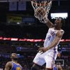Oklahoma City\'s Hasheem Thabeet (34) dunks the ball beside Golden State\'s Festus Ezeli (31) during an NBA basketball game between the Oklahoma City Thunder and the Golden State Warriors at Chesapeake Energy Arena in Oklahoma City, Wednesday, Feb. 6, 2013. Photo by Bryan Terry, The Oklahoman
