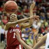 OU\'s Nyeshia Stevenson passes the ball around Notre Dame\'s Ashley Barlow during the Sweet 16 round of the NCAA women\'s basketball tournament in Kansas City, Mo., on Sunday, March 28, 2010. Photo by Bryan Terry, The Oklahoman