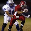 Carl Albert\'s Sterling Wright (7) breaks a tackle attempt by Guthrie\'s Josh King (44) in first half action in high school football at Jim Harris Stadium in Midwest City, Oklahoma on Thursday October 16, 2008. BY STEVE SISNEY, THE OKLAHOMAN