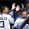 Photo - Detroit Tigers second baseman Ian Kinsler celebrates his solo home run off Kansas City Royals pitcher Jason Vargas in the fourth inning of a baseball game in Detroit Wednesday, April 2, 2014. (AP Photo/Paul Sancya)