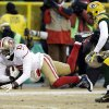 Photo - San Francisco 49ers wide receiver Michael Crabtree (15) makes a reception against Green Bay Packers cornerback Micah Hyde (33) during the first half of an NFL wild-card playoff football game, Sunday, Jan. 5, 2014, in Green Bay, Wis. (AP Photo/Mike Roemer)