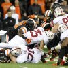 Photo - Stanford's Tyler Gaffney (25) works against Oregon State defenders during the first half of an NCAA college football game in Corvallis, Ore., Saturday Oct. 26, 2013. (AP Photo/Greg Wahl-Stephens)