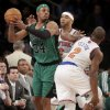 Boston Celtics\' Paul Pierce, left, looks to pass around New York Knicks\' Kenyon Martin, center, and Raymond Felton during the first half of an NBA basketball game at Madison Square Garden Sunday, March 31, 2013 in New York. (AP Photo/Seth Wenig)
