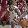 Oklahoma Sooners\' Romero Osby (24) tries to retrieve a loose ball as the University of Oklahoma (OU) Sooners play the South Carolina State Bulldogs in men\'s college basketball at the Lloyd Noble Center on Wednesday, Dec. 21, 2011, in Norman, Okla. Photo by Steve Sisney, The Oklahoman