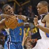 Oklahoma City\'s Russell Westbrook (0) fouls New Orleans\' Chris Paul (3) during the NBA basketball game between the Oklahoma City Thunder and the New Orleans Hornets, Wednesday, Feb. 2, 2011 at the Oklahoma City Arena. Photo by Bryan Terry, The Oklahoman