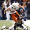 Oklahoma State\'s Josh Cooper (25) is brought down by Arizona\'s Joseph Perkins (9) during the Valero Alamo Bowl college football game between the Oklahoma State University Cowboys (OSU) and the University of Arizona Wildcats at the Alamodome in San Antonio, Texas, Wednesday, December 29, 2010. OSU won, 36-10. Photo by Sarah Phipps, The Oklahoman