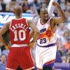 Phoenix Suns basketball forward Wayman Tisdale gestures after making a basket as he heads past Houston Rockets guard Sam Cassell in the second period of their NBA playoff game Thursday, May 11, 1995, in Phoenix. (AP Photo/Scott Troyanos)