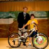 Assistant Principal Cara Jernigan looks on while Michael Root presents Cole Brown with a new bicycle. Cole was the top student at Will Rogers Elementary, Edmond, in earning accelerated reader points. Accelerated Reader is a reading program where students take computerized quizzes on books they have read and are awarded points for correct answers. Mr. Root of Terra Quest, an Edmond based oil company generously donated the terrific bike. Community Photo By: Jennetta Koester Submitted By: Jennetta,