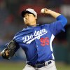 Los Angeles Dodgers starting pitcher Ryu Hyun-jin delivers in the first inning of an exhibition spring training baseball game against the Los Angeles Angels in Anaheim, Calif., Thursday, March 28, 2013. (AP Photo/Christine Cotter)