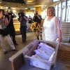 Nancy Levindowski makes her entrance into the Denny\'s restaurant on Fremont Street in Las Vegas, for her wedding to Steve Keller Wednesday, April 4, 2013. (AP Photo/Las Vegas Sun, Sam Morris)