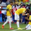 Photo - Brazil's Willian, right, Brazil's David Luiz and Brazil's Neymar celebrate after the World Cup round of 16 soccer match between Brazil and Chile at the Mineirao Stadium in Belo Horizonte, Brazil, Saturday, June 28, 2014. Brazil won 3-2 on penalties. Brazil won 3-2 on penalties.(AP Photo/Frank Augstein)