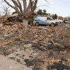 Photo - Debris is scattered up to a hundred yards away from a house which exploded at 12409 Whispering Hollow Drive in Oklahoma City, OK, Saturday, January 2, 2016. The cause of the explosion is being investigated. Photo by Paul Hellstern, The Oklahoman