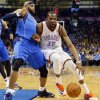 Oklahoma City\'s Kevin Durant (35) drives against Dallas\' Vince Carter (25) during an NBA basketball game between the Oklahoma City Thunder and the Dallas Mavericks at Chesapeake Energy Arena in Oklahoma City, Sunday, March 16, 2014. Photo by Nate Billings, The Oklahoman