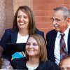In a Monday, Sept. 19, 2011 photo, defendant Bobbi Parker, top left, enjoys a few moments with her husband, Randy, right, and other family members during a break from her trial late Monday afternoon. Jurors deliberating to decide whether Parker helped a convicted killer escape or whether she was kidnapped and held in check through threats for more than a decade asked the court Tuesday, Sept. 20, 2011 if they could tour the home on the prison grounds where the warden and his wife lived. (Photo by Jim Beckel, The Oklahoman)