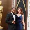 Photo - Chiwetel Ejiofor, left, and Sari Mercer arrive at the Oscars on Sunday, March 2, 2014, at the Dolby Theatre in Los Angeles.  (Photo by Jordan Strauss/Invision/AP)