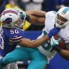 Photo - Buffalo Bills middle linebacker Kiko Alonso (50) tackles Miami Dolphins wide receiver Rishard Matthews (18) during the second half of an NFL football game Sunday, Dec. 22, 2013, in Orchard Park, N.Y. (AP Photo/Bill Wippert)