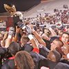 Tulsa Union players hoist the gold ball in the air after winning the Class 6A state championship Friday. Photo by JOEY JOHNSON, For the Tulsa World
