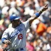 Photo -   Los Angeles Dodgers' Hanley Ramirez reacts after scoring during the fourth inning of a baseball game against the in San Francisco, Sunday, July 29, 2012. (AP Photo/Tony Avelar)