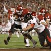 OU\'s DeMarco Murray fights of Bront Bird of Texas Tech for a touchdown during the college football game between the University of Oklahoma Sooners and Texas Tech University at Gaylord Family -- Oklahoma Memorial Stadium in Norman, Okla., Saturday, Nov. 22, 2008. BY BRYAN TERRY, THE OKLAHOMAN