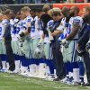 Photo - Dallas Cowboys players hang their heads during a moment of silence honoring teammate Jerry Brown who was killed in an automobile accident prior to an NFL football game against the Cincinnati Bengals, Sunday, Dec. 9, 2012, in Cincinnati. (AP Photo/Al Behrman)