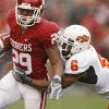 Oklahoma\'s Chris Brown (29) looks for running room past Oklahoma State\'s Ricky Price (6) during the first half of the college football game between the University of Oklahoma Sooners (OU) and the Oklahoma State University Cowboys (OSU) at the Gaylord Family-Memorial Stadium on Saturday, Nov. 24, 2007, in Norman, Okla. Photo By Bryan Terry, The Oklahoman