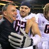 Arizona head coach Tim Kish, left, celebrates a win over Arizona State with players Chris Putton (62) and Nick Foles (8) after an NCAA college football game, Saturday, Nov. 19, 2011, in Tempe, Ariz. Arizona defeated Arizona State 31-27. (AP Photo/Ross D. Franklin)