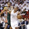 Photo - Milwaukee Bucks forward John Henson, left, fouls Miami Heat forward Shane Battier (31) as he goes up for a shot during the first half of Game 2 in their first-round NBA basketball playoff series, Tuesday, April 23, 2013 in Miami. (AP Photo/Wilfredo Lee)