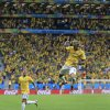 Photo - Brazil's Neymar leaps in the air to celebrate after scoring his side's second goal during the group A World Cup soccer match between Cameroon and Brazil at the Estadio Nacional in Brasilia, Brazil, Monday, June 23, 2014. (AP Photo/Bernat Armangue)