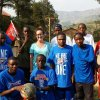 Betsy Dewey, a Peace Corps volunteer from Oklahoma City, is surrounded by her students in Rwanda. Dewey\'s father, Lyle, provided the Oklahoma City Thunder NBA basketball gear for the students on a trip to Africa last month. Photo provided