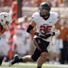 Oklahoma State\'s Josh Cooper (25) gets by Texas\' Christian Scott (6) during first half of a college football game between the Oklahoma State University Cowboys (OSU) and the University of Texas Longhorns (UT) at Darrell K Royal-Texas Memorial Stadium in Austin, Texas, Saturday, Oct. 15, 2011. Photo by Sarah Phipps, The Oklahoman