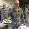 Soldier pass through a line to receive pizza of their choice from a Blue Star Mother. A US Army spokesman from Ft. Sill said nearly 1,000 troops boarded buses for the trip to Will Rogers World Airport in Oklahoma City to catch flights home for the Christmas holidays. Buses filled with soldiers began arriving at the airport after midnight Wednesday and into the pre-dawn hours on Thursday, Dec. 19, 2013. While waiting to board flights, the troops were treated to food and warm beverages at the YMCA Military Welcome Center at the airport. Soldiers were offered pizza, doughnuts and sub sandwiches, with hot coffee or chocolate, and bottled water. Friendly faces from local organizations were there to greet them and assist them. Volunteers represented several groups, including Blue Star Mothers, Patriot Guard Riders and an organization consisting of Purple Heart recipients. Photo by Jim Beckel, The Oklahoman