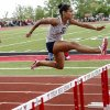 Shawnee\'s Jasmine Robinson leads the race in the 5A girls 100m hurdles during the class 5A and 6A track state championships at Yukon High School on on Friday, May 10, 2013, in Yukon, Okla.Photo by Chris Landsberger, The Oklahoman