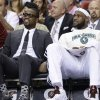Miami Heat guard Dwyane Wade, left, sits on the bench with forward LeBron James during the first half of an NBA basketball game against the Milwaukee Bucks, Tuesday, April 9, 2013 in Miami. Wade was ruled out of Tuesday\'s home game against the Bucks, the fifth straight contest that the All-Star guard will miss while tending to a sprained ankle and bruised knee. (AP Photo/Wilfredo Lee)