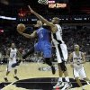 Oklahoma City\'s Russell Westbrook (0) goes past San Antonio\'s Tim Duncan (21) during Game 2 of the Western Conference Finals between the Oklahoma City Thunder and the San Antonio Spurs in the NBA playoffs at the AT&T Center in San Antonio, Texas, Tuesday, May 29, 2012. Oklahoma City lost 120-111. Photo by Bryan Terry, The Oklahoman