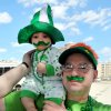 Photo - John Palenzuela of Webster, Texas holds his son, Kayden, 6 months old, as they watch the Houston St. Patrick's Day Parade in downtown Houston, Texas on Saturday, March 16, 2013. (AP Photo/The Courier, Alan Warren)