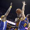 Photo - Los Angeles Lakers guard Nick Young, center, loses the ball between Golden State Warriors guard Klay Thompson (11) and center Jermaine O'Neal, left, in the first quarter during an NBA preseason basketball game Saturday, Oct. 5, 2013, in Ontario, Calif. (AP Photo/Alex Gallardo)