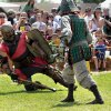 Photo - A knight falls during a jousting match at last year's Medieval Fair at Reaves Park in Norman. OKLAHOMAN ARCHIVES